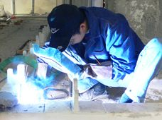 a Chinese worker site-welding at WFC´s Crystal Wall´s structure